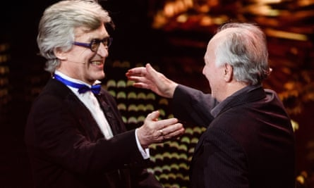 Wim Wenders (left) congratulates fellow German director Werner Herzog as Herzog receives the EFA lifetime achievement award
