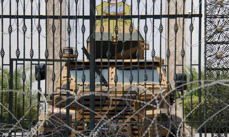 An armoured vehicle and razor wire block a side entrance to the Tunisian parliament in Tunis