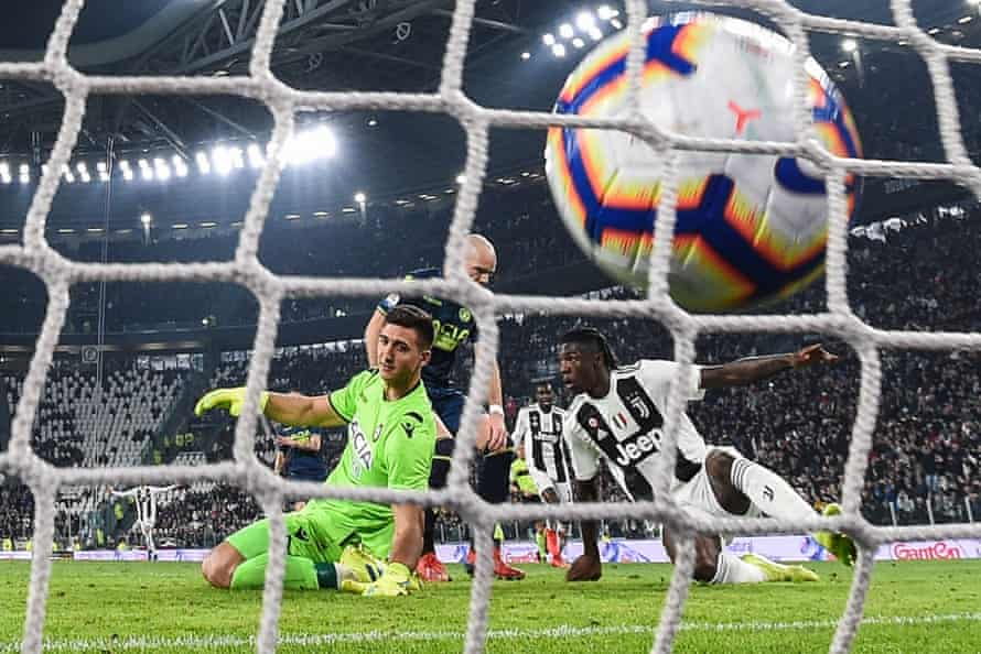 Moise Kean pounces to beat Juan Musso in the Udinese goal and give Juventus the lead.