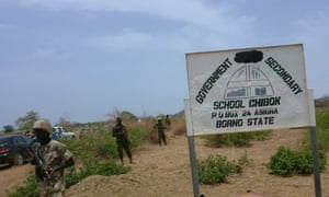 Soldiers stand guard in front of the government secondary school in Chibok.