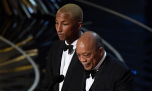 Quincy Jones addressing the Oscars ceremony accompanied by Pharrell Williams