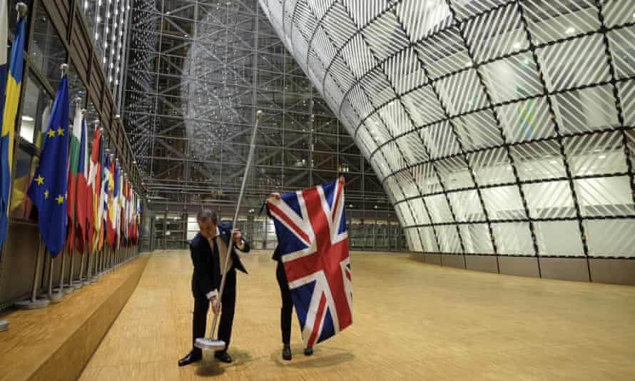 The Union flag is removed from the atrium of the Europa building on 31 January, 2020 in Brussels.