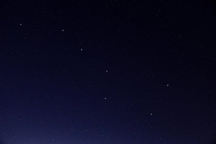 Stars of the Plough constellation in the night sky.
