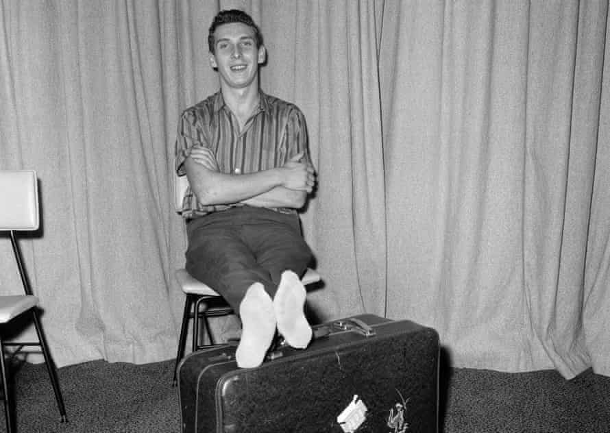 Brian Robson with his feet on a suitcase