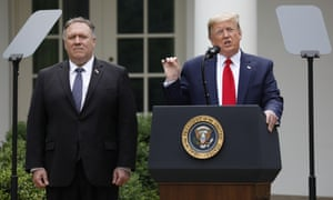 United States President Donald Trump delivers remarks on China in the Rose Garden at the White House in Washington, DC on 29 May 2020. At left is US Secretary of State Mike Pompeo.