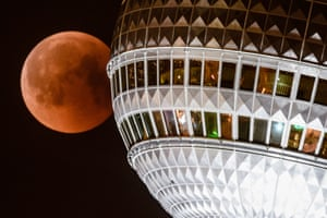 Great juxtaposition from this photographer of the moon appearing to collide with the Berlin TV Tower, Germany.