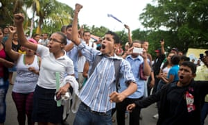 Residents shout slogans during a protest march against the construction of the planned interoceanic canal, in San Jorge, Nicaragua, on 3 October 2014.