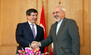 Turkish foreign minister Ahmet Davutoğlu, left, with Iranian foreign minister Mohammad Javad Zarif in 2013