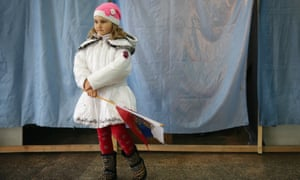 A girl stands with a Russian flag in Bachchisaray, Crimea, 2014.