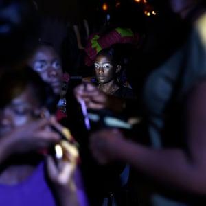 Models sit backstage during Dakar fashion week, June 2017