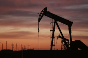 An oil pumpjack works at dawn in the Permian Basin oil field in Andrews, Texas