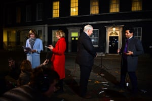 Laura Kuenssberg (in red) outside 10 Downing Street  with the BBC's Fiona Bruce and Adam Boulton and Faisal Islam of Sky News, November 2018.