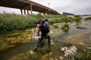 Migrants cross the Bravo river at the border between Ciudad Juárez, Mexico, and El Paso in Texas.