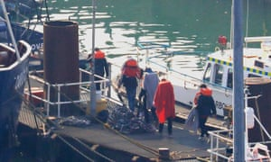 A group of men are brought to shore by Border Force officers at the Port of Dover in Kent