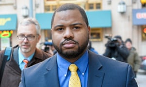 Baltimore police officer William Porter arrives at the courthouse for pretrial hearings in the case of Caesar Goodson.