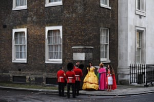London, England Welsh Guards and actors dressed as Disney princesses