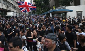A protester waves a British flag in Mongkok on Saturday