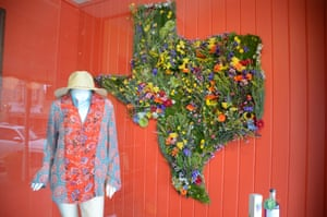 A floral decoration in the shape of the state of Texas in a shop window in Fredericksburg