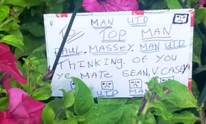 Floral tribute and card left at the scene of the shooting in Clifton, Greater Manchester.