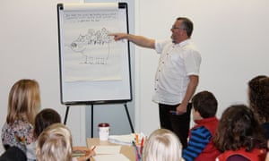 Harry Venning releasing families inner cartooning skills at the Guardian cartoon and art family day.