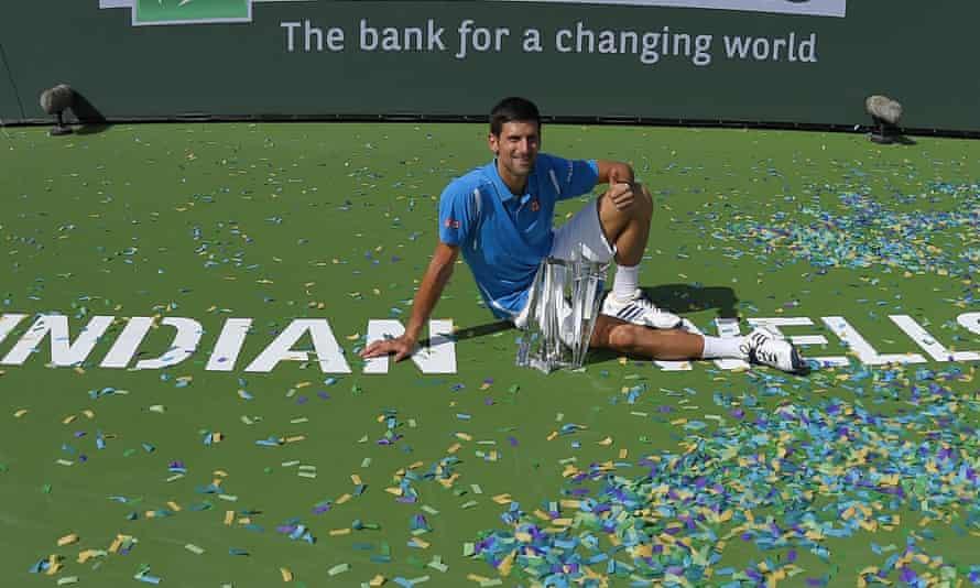 Novak Djokovic poses on the court after winning the BNP Paribas Open