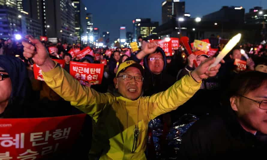 South Koreans celebrate after the constitutional court upheld the impeachment of Park Geun-hye.