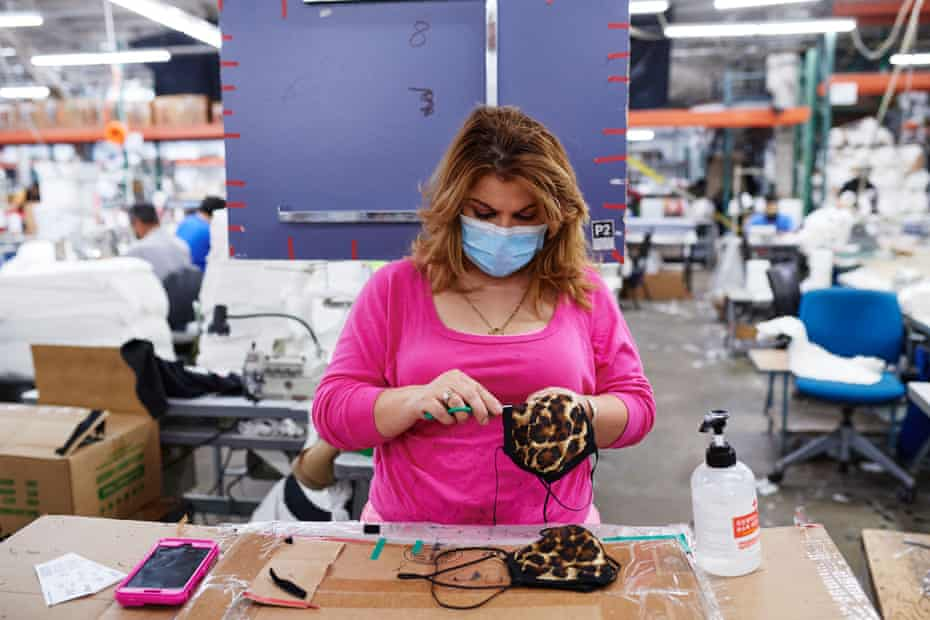 A factory worker makes masks at an LA Apparel factory in April.