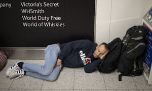A passenger takes a nap on the floor