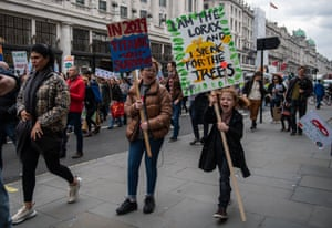 Student protesters march up Regents Street