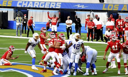 The Chargers and Chiefs watch as Harrison Butker's winning kick takes flight