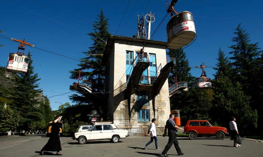 People pass a cable car station that is not running during a power cut in the town of Chiatura, some 220 km (136 miles) northwest of Tbilisi.