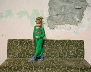 Dalia, five, outside a school building in Haj Ali where families sought refuge after fleeing the fighting in Mosul.