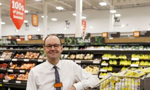 Mike Coupe, CEO of Sainsbury's poses in a store