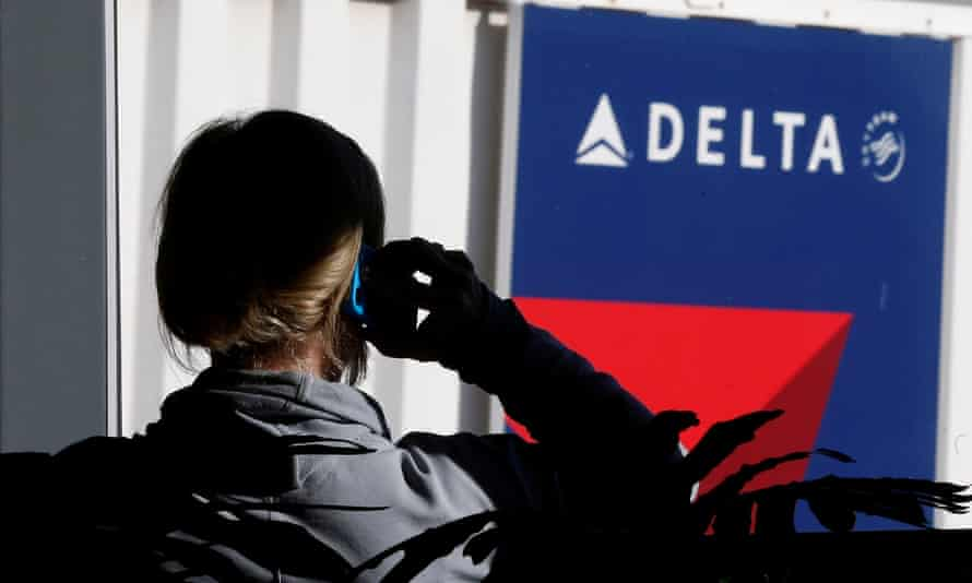 A passenger talks on her phone at a Delta Airlines gate at the Salt Lake City international airport<br>FILE PHOTO - A passenger talks on her phone at a Delta Airlines gate a day before the annual Thanksgiving Day holiday at the Salt Lake City international airport, in Salt Lake City, Utah November 21, 2012. REUTERS/George Frey/File Photo