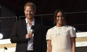 Prince Harry, the Duke of Sussex, left, and Meghan Markle, the Duchess of Sussex, speak at Global Citizen Live in Central Park, New York.