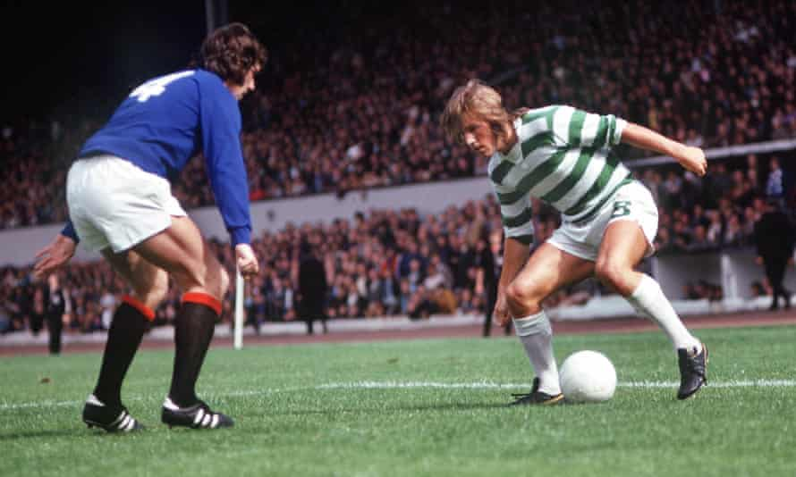 Kenny Dalglish takes on Rangers' John Greig during the 1974 Drybrough Cup final