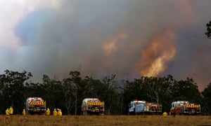 A bushfire approaches Old Bar, New South Wales, on Sunday.