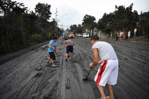 Residents help clear a road covered in Tanauan town in Batangas province