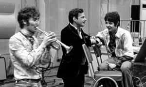 Brian Epstein, centre, with John Lennon and Paul McCartney at Abbey Road studios.