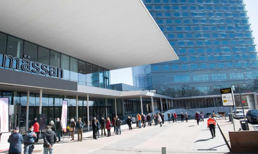 People queue for their vaccine against Covid-19 at the Stockholmsmässan centre in Stockholm, Sweden.