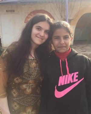 Berivan and a friend in Jinwar.