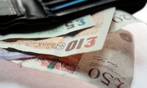 High denomination pound notes fan out from a wallet