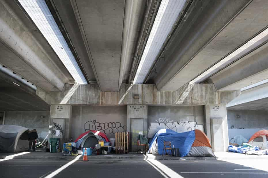 Tents line a sidewalk under an overpass at the 27th and Northgate homeless encampment in Oakland, California.