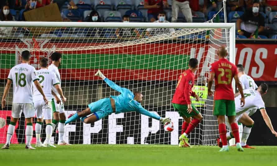Cristiano Ronaldo heads Portugal's 89th-minute equaliser past the Republic of Ireland goalkeeper Gavin Bazunu