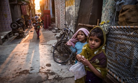 Young children play on the cramped streets of Delhi.