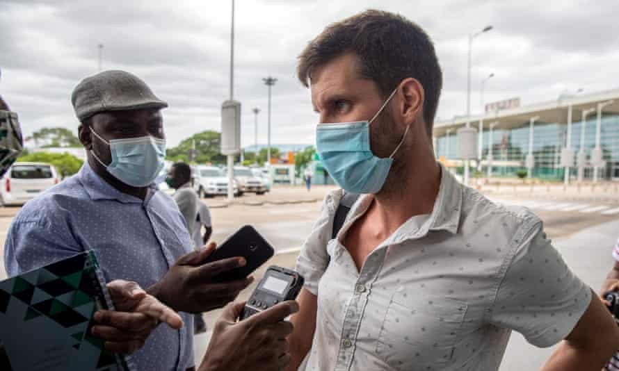 Tom Bowker speaks to journalists at Maputo airport before boarding his flight out of Mozambique