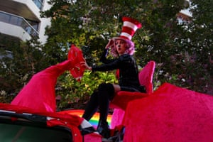 A parade-goer sits on a float on Oxford Street