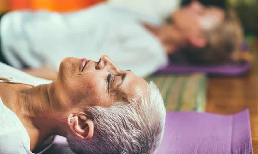Close up of head of a woman lying on a yoga mat