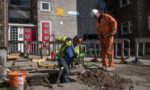 Engineers work to disconnect the gas supply on the Ledbury Estate on Friday.
