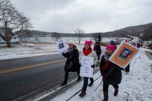Women march along a frosty road